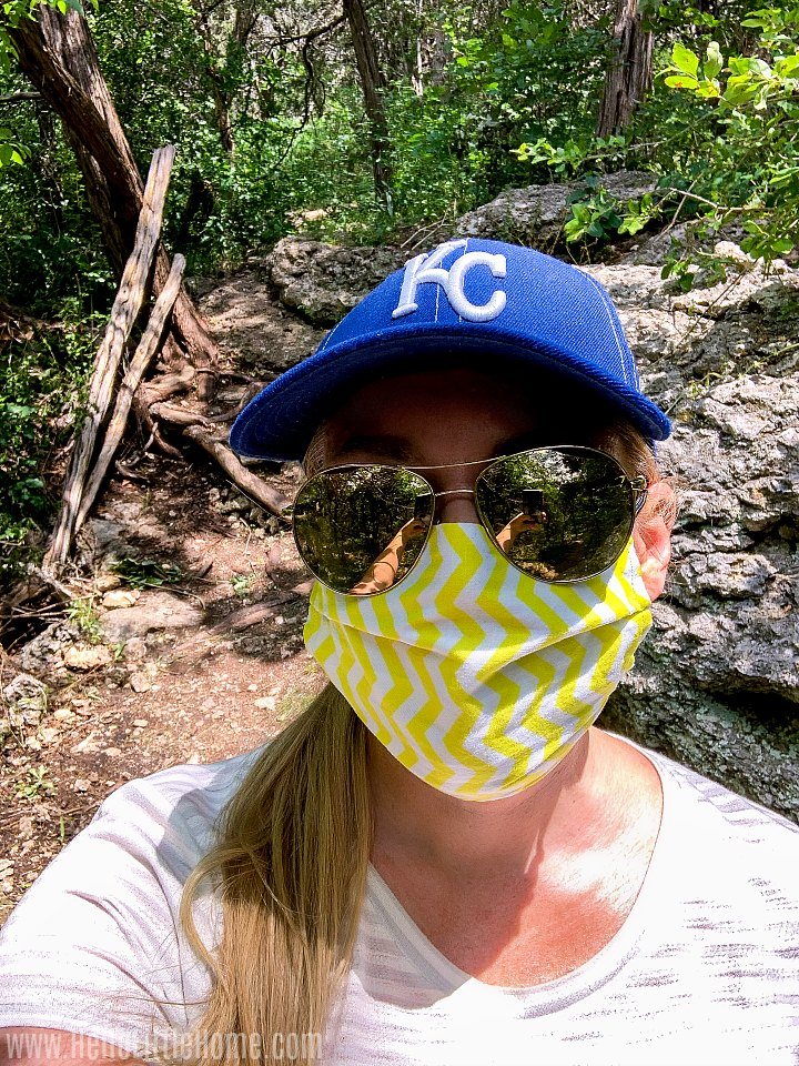 Me wearing a yellow mask while hiking at Mother Neff State Park.