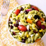 A small bowl of Southwestern Pasta Salad on a bright yellow napkin.
