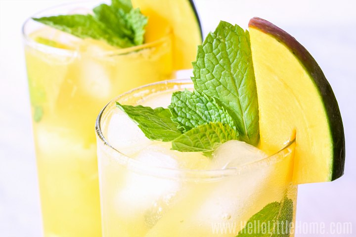Closeup of the finished mango drink garnished with mint and mango slices.