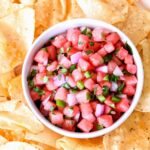 Watermelon Salsa in a bowl surrounded by chips.