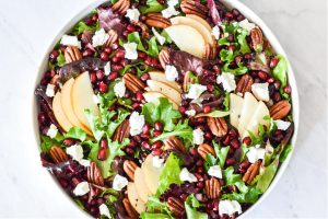 The finished salad recipe served in a round serving bowl.