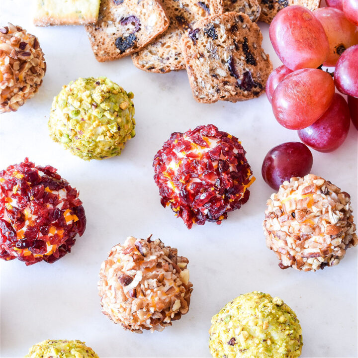 Savory Cheese Truffles, crackers, and grapes on a tray.