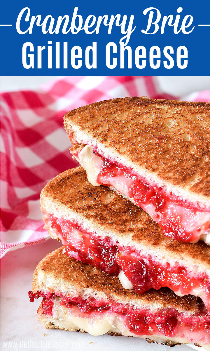 Cranberry Brie Grilled Cheese Sandwiches arranged in a stack.