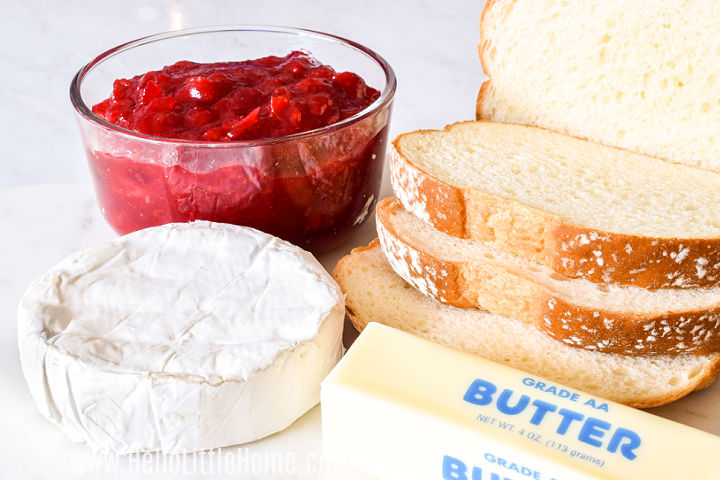 Cranberry Brie Sandwich ingredients arranged on a marble tray.