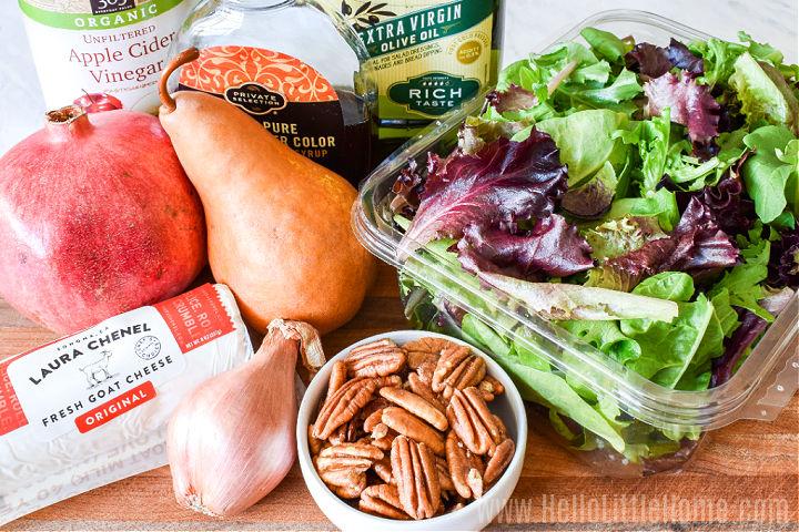 Salad ingredients arranged on a cutting board.