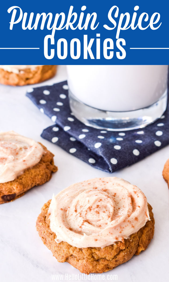 Pumpkin Spice Cookies on a marble counter with a glass of milk in the background.