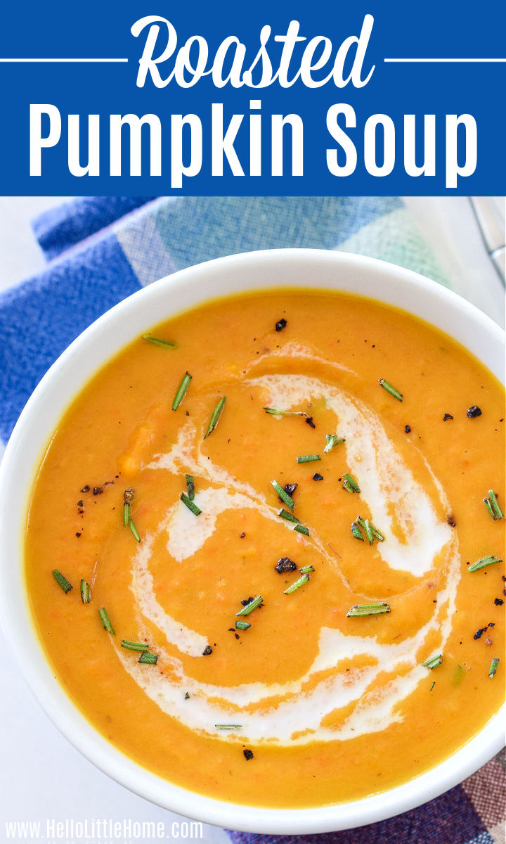 A bowl of Roasted Pumpkin Soup drizzled with coconut milk and sprinkled with fresh rosemary.