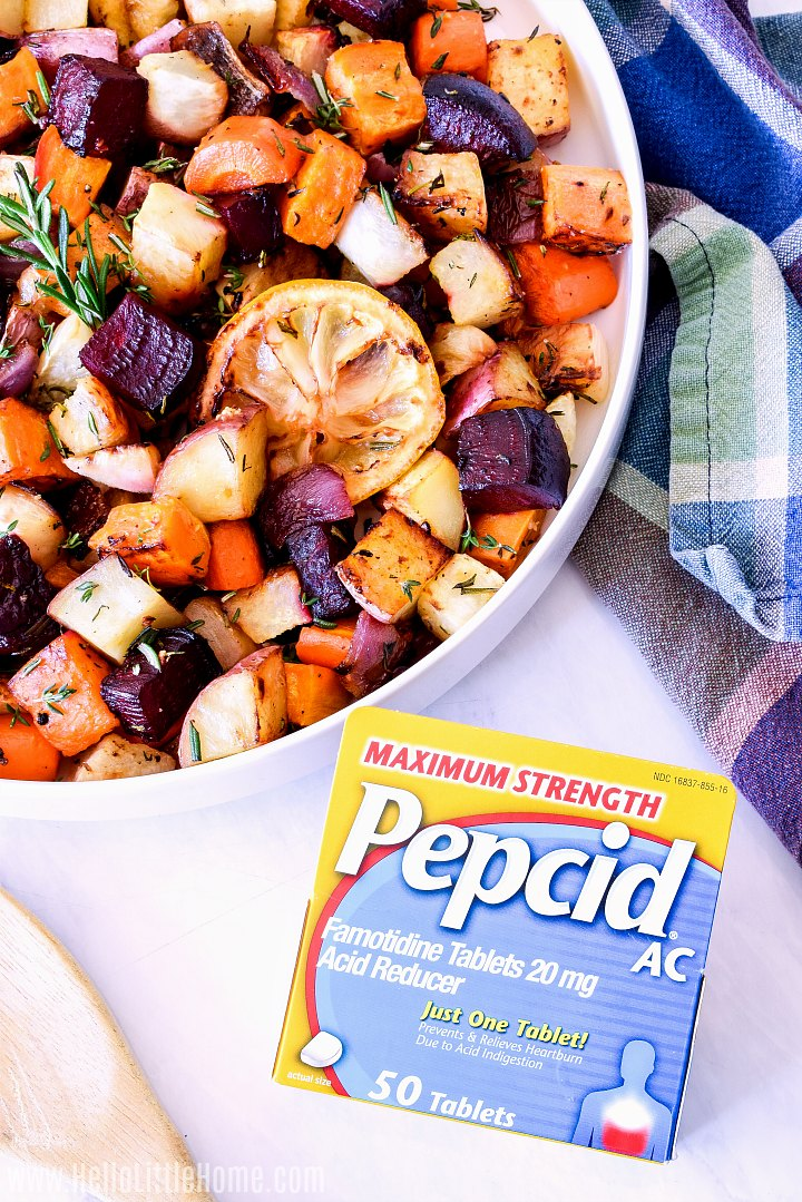 A platter of the veggies and box of Pepcid on a marble counter.