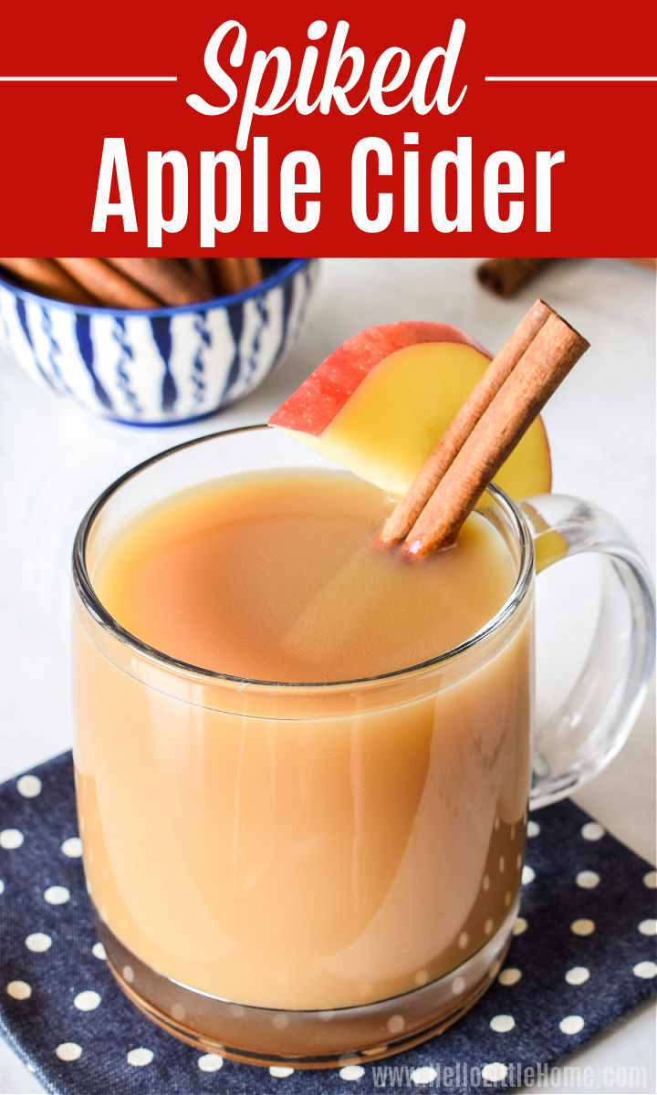 Spiked Apple Cider Cocktail garnished with an apple slice and cinnamon stick.