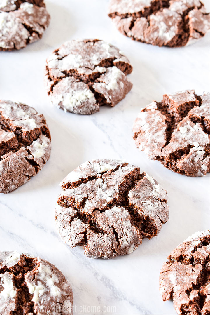 A bunch of cookies on a marble counter.