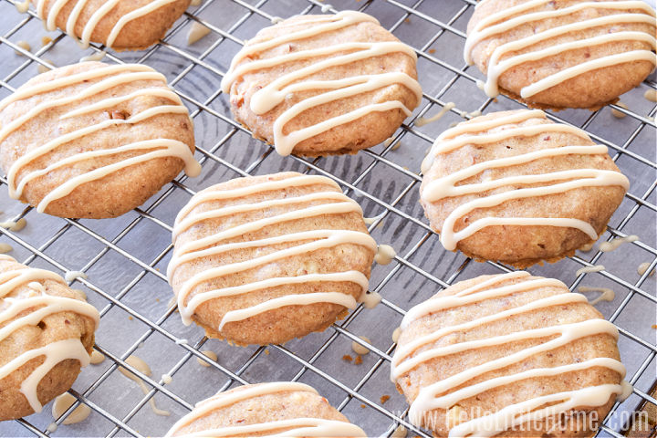 The cookies resting on a cooling rack after being drizzled with maple icing.