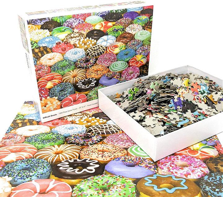 A donut jigsaw puzzle on a table.