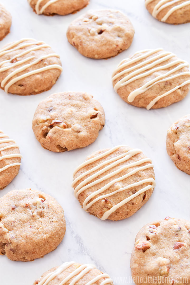 A bunch of Maple Pecan Cookies on a counter.