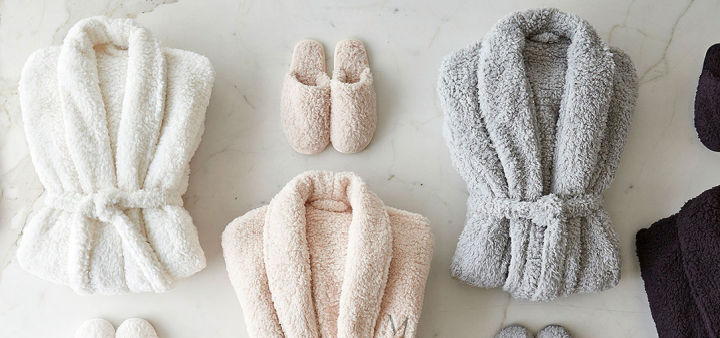 Robes and slippers arranged on a white background.