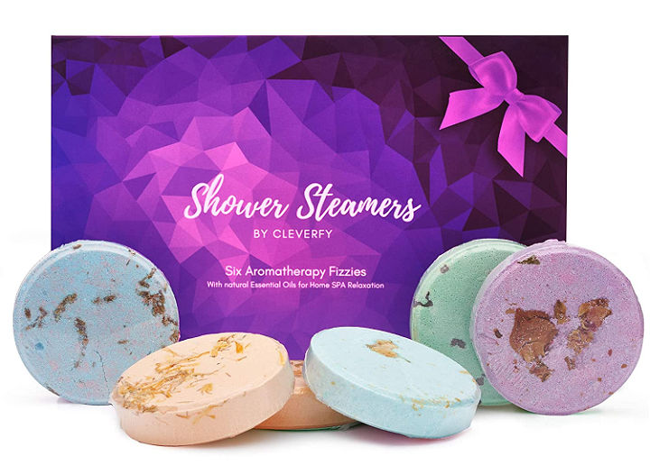 Shower steamers arranged in front of a box.