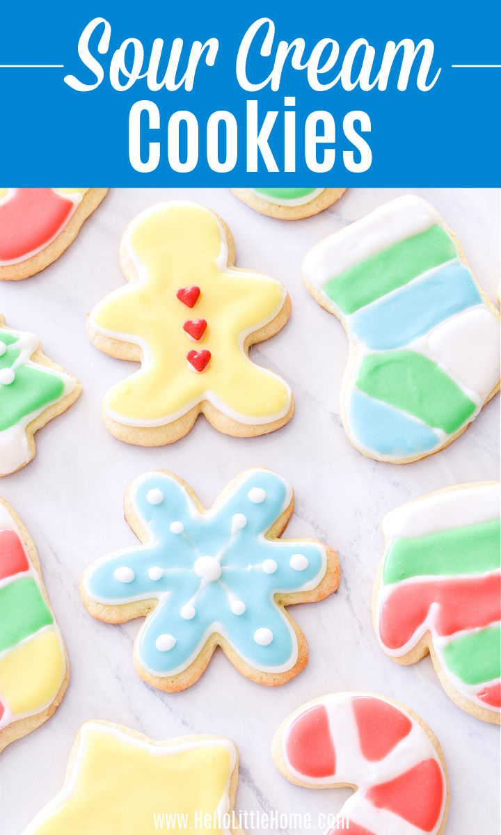 Colorful Sour Cream Cut Out Cookies on a white counter.
