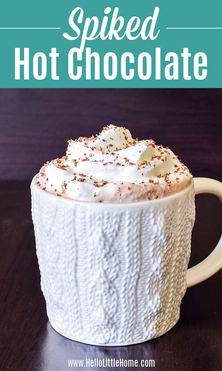 A mug of Boozy Hot Cocoa on a wood table.