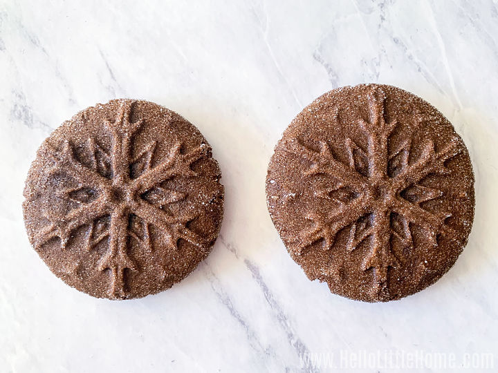 Two cookies side by side on a marble counter.