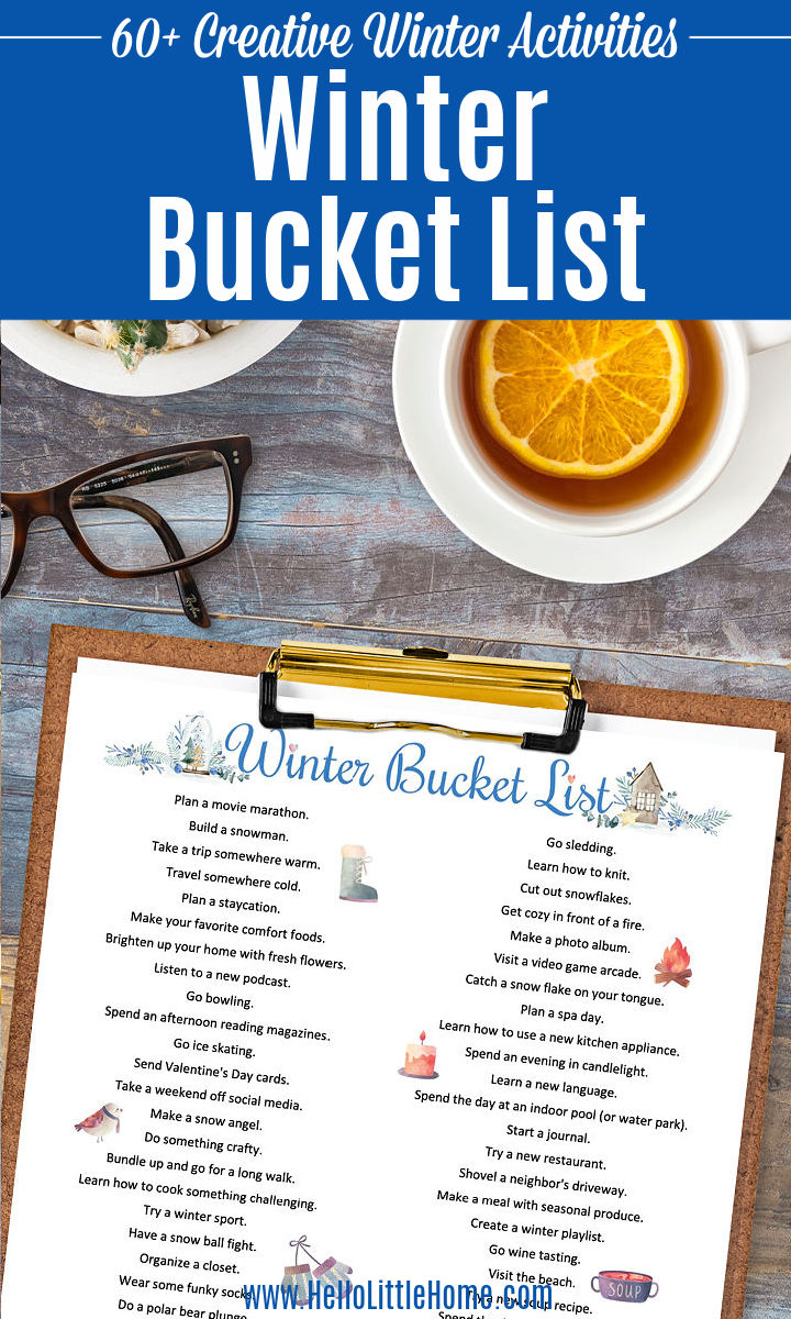 The list of winter activities on a clipboard next to glasses and tea.