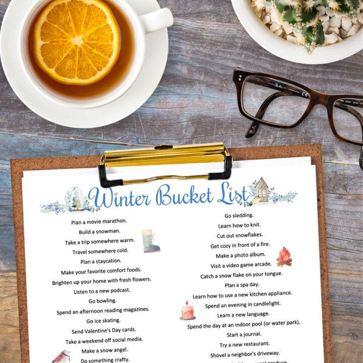 A Winter Bucket List on a clipboard.