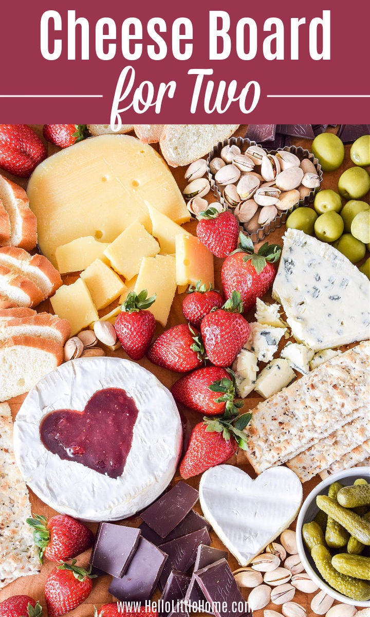 Cheese and other ingredients arranged closely together on a wood board.