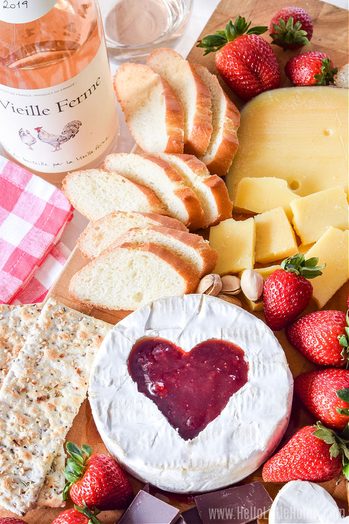 A date night cheese board next to a bottle of rose wine.