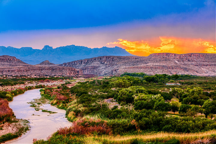 A vibrant sunset of the Rio Grande River in Big Bend National Park.