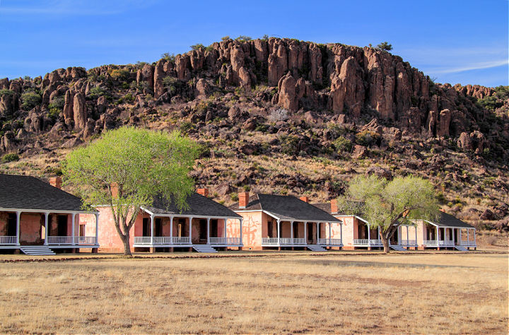 A row of barracks with a mountain in the background at Fort Davis National Historic Site.