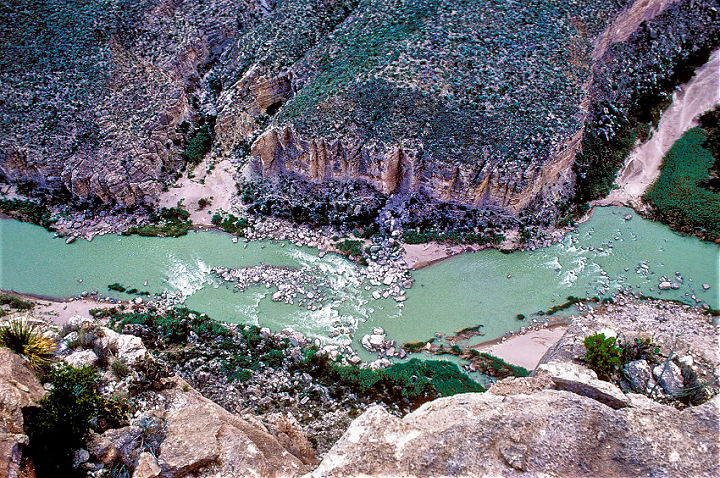 An overhead image of the Rio Grande River surrounded by a rocky canyon.