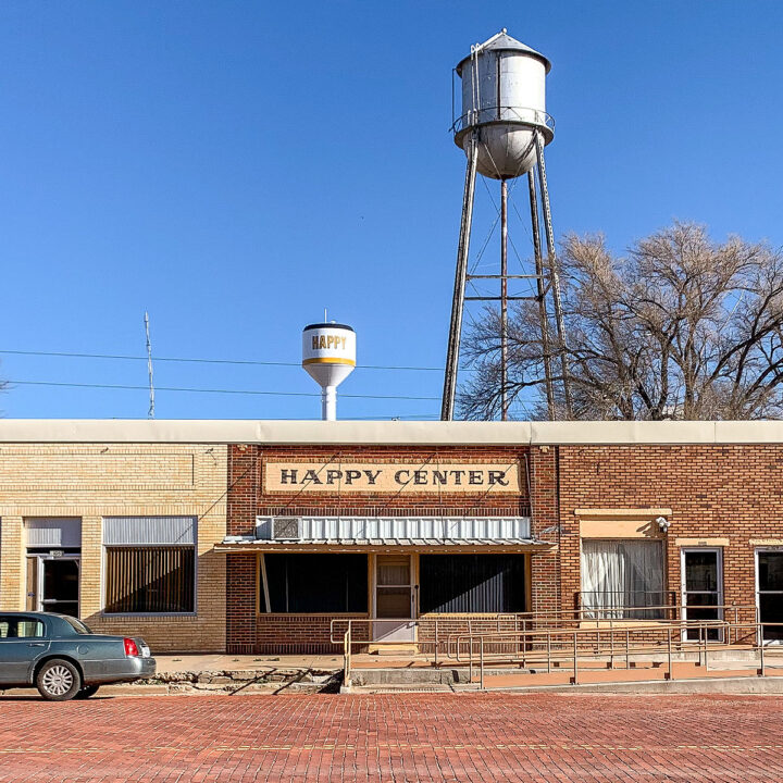 The Happy Center in Happy, Texas with two water towers in the background.