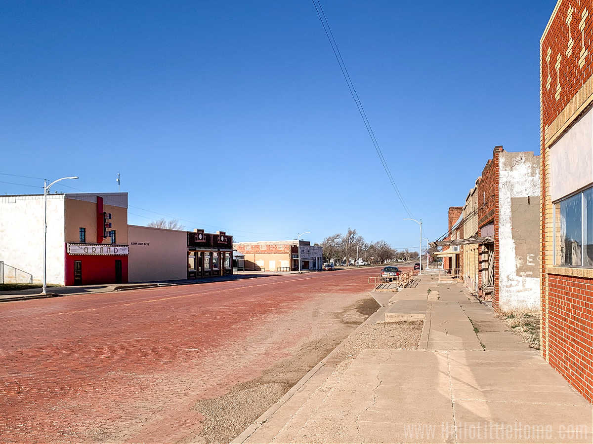 A brick street lined with small buildings.