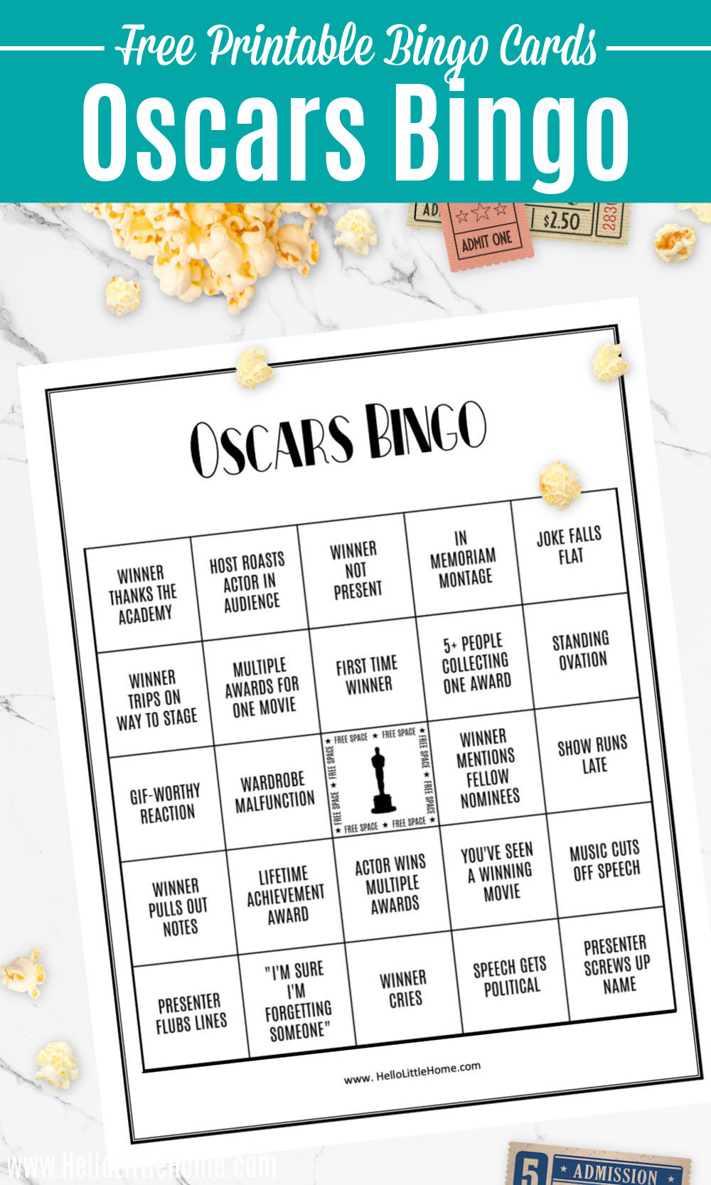 The printable Oscars Bingo Card on a table with popcorn and movie tickets.