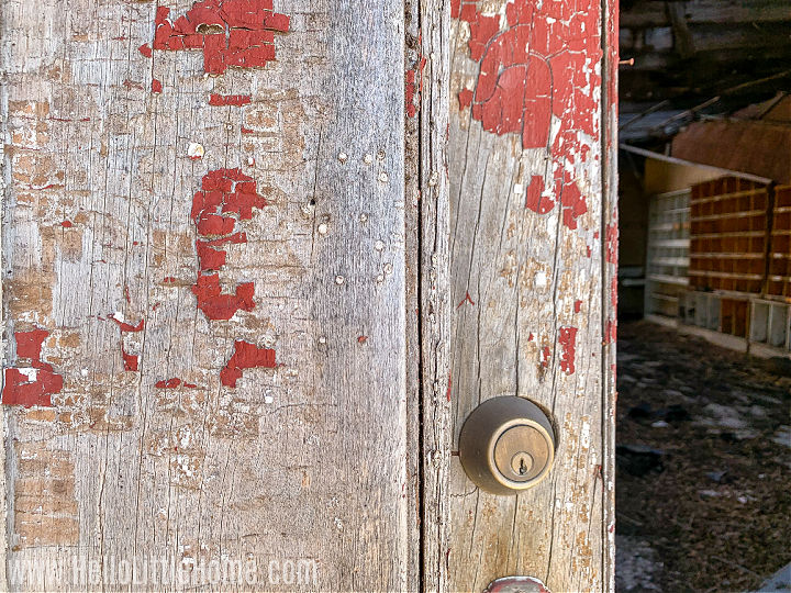 Closeup of a weathered door with peeling paint.