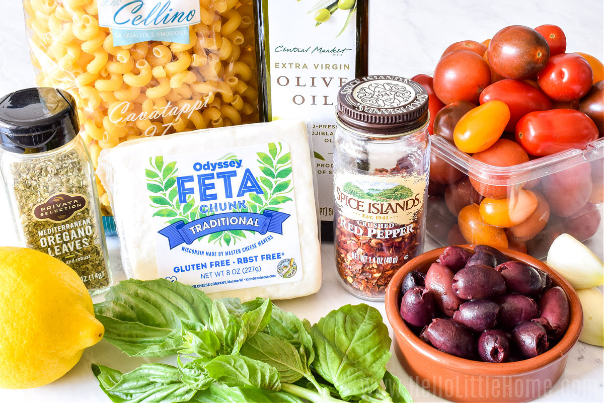 Feta Pasta ingredients arranged on a marble counter.