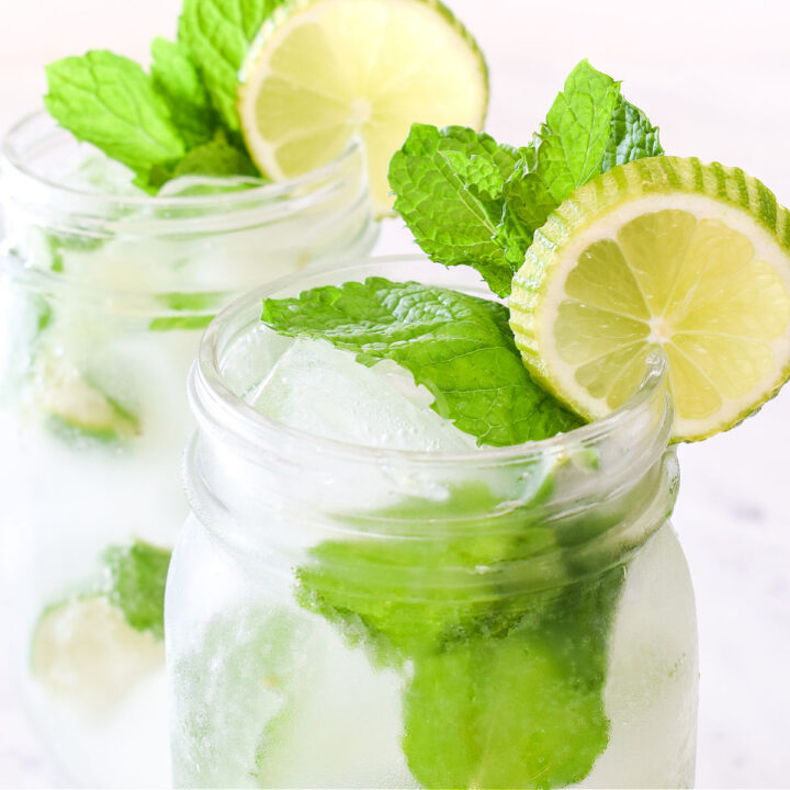 Closeup of a Virgin Mojito garnished with mint and a lime slice.