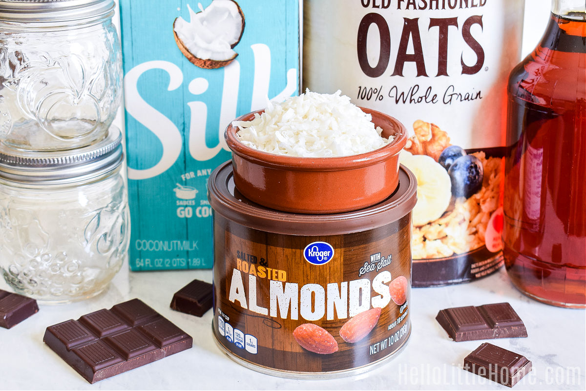 Ingredients for Almond Joy Oatmeal arranged on a marble counter.