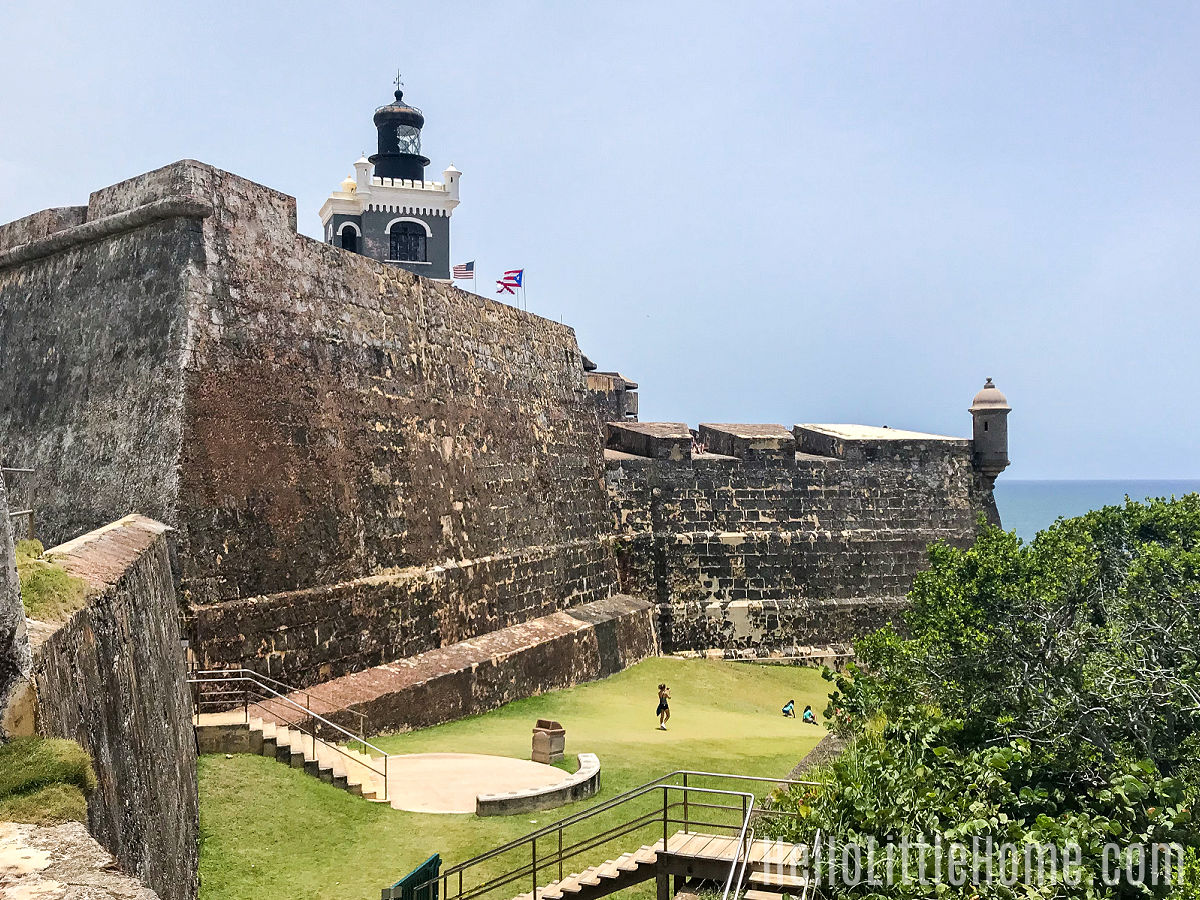 A view of the lighthouse, walls, and grounds at El Morro Fort in San Juan.