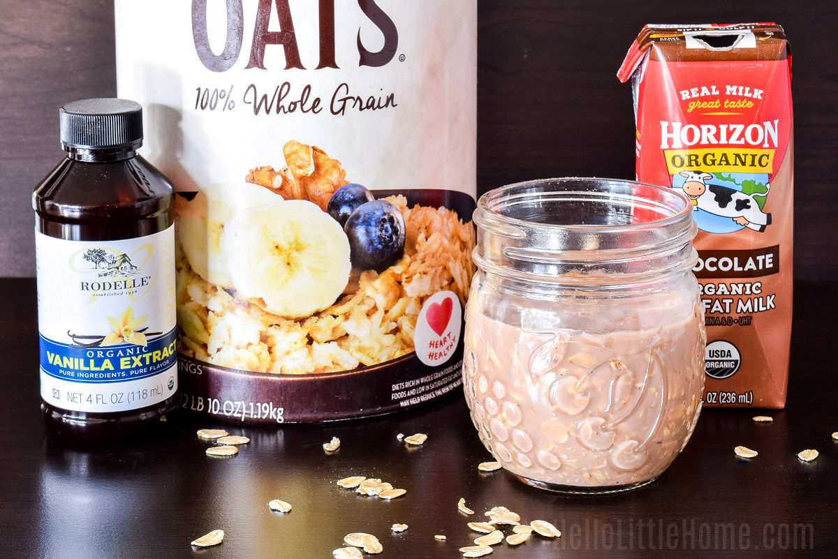 Chocolate and oats mixed together in a jar, next to a few other ingredients.