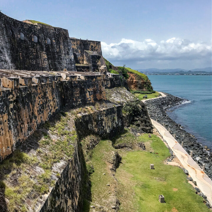 The exterior of El Morro, the National Park in Puerto Rico, next to the ocean.
